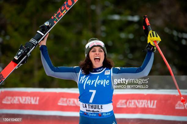 Second Placed Italy's Federica Brignone celebrates during the podium ceremony of the FIS Alpine Skiing World Cup Women's Super G on February 29 2020...