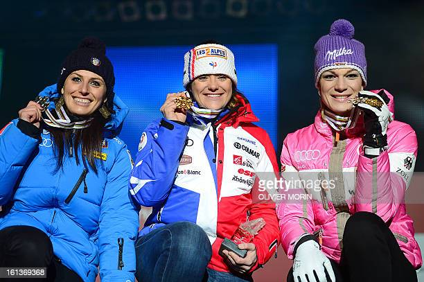 Second placed Italy's Nadia Fanchini, winner France's Marion Rolland and Germany's Maria Hoefl-Riesch celebrate during the medals ceremony after the...