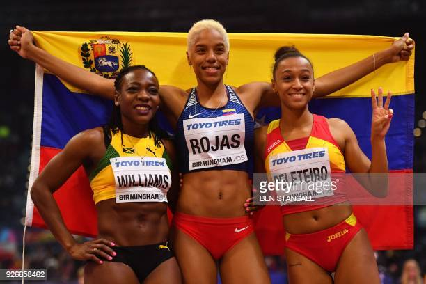 Second placed Jamaica's Kimberly Williams winner Venezuela's Yulimar Rojas and third placed Spain's Ana Peleteiro pose after the women's triple jump...