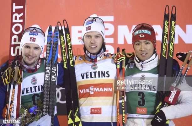 Second placed Jan Schmid of Norway Espen Andersen of Norway and third placed Akito Watabe of Japan pose on the podium after the Nordic Combined Men's...