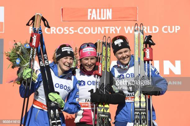 Second placed Jessica Diggins of the US winner Marit Bjoergen of Norway and third placed Sadie Bjornsen of the US pose on the podium after the FIS...