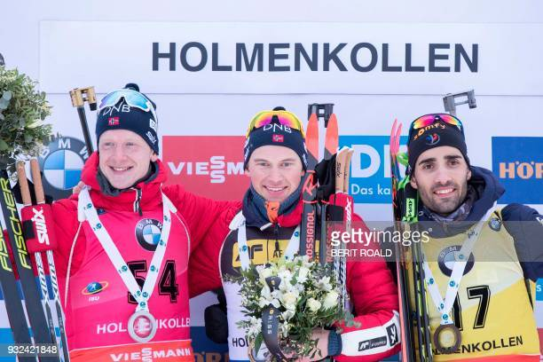 Second placed Johannes Thingnes Boe form Norway winner Henrik L'AbeeLund from Norway and third placed Martin Fourcade from France celebrate on the...
