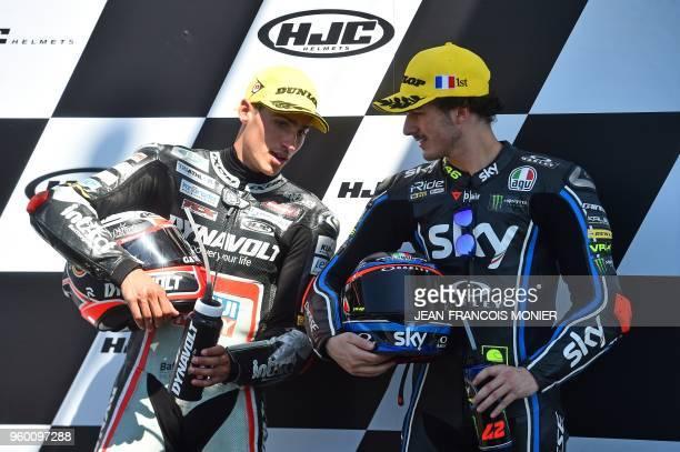 Second placed Kalex Dynavolt Intact GP Spanish's rider Xavier Vierge and Kalex Sky Racing Team VR46 Italian's rider Francesco Bagnaia celebrate on...