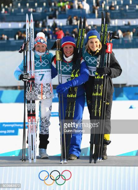 Second placed Krista Parmakoski of Finland first placed Marit Bjoergen of Norway and third placed Stina Nilsson of Sweden celebrate following the...