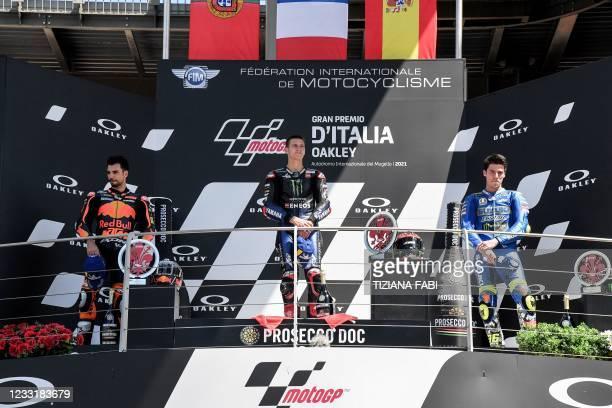 Second placed KTM Portuguese rider Miguel Oliveira, winner Yamaha French rider Fabio Quartararo and third placed Suzuki Spanish rider Joan Mir stand...