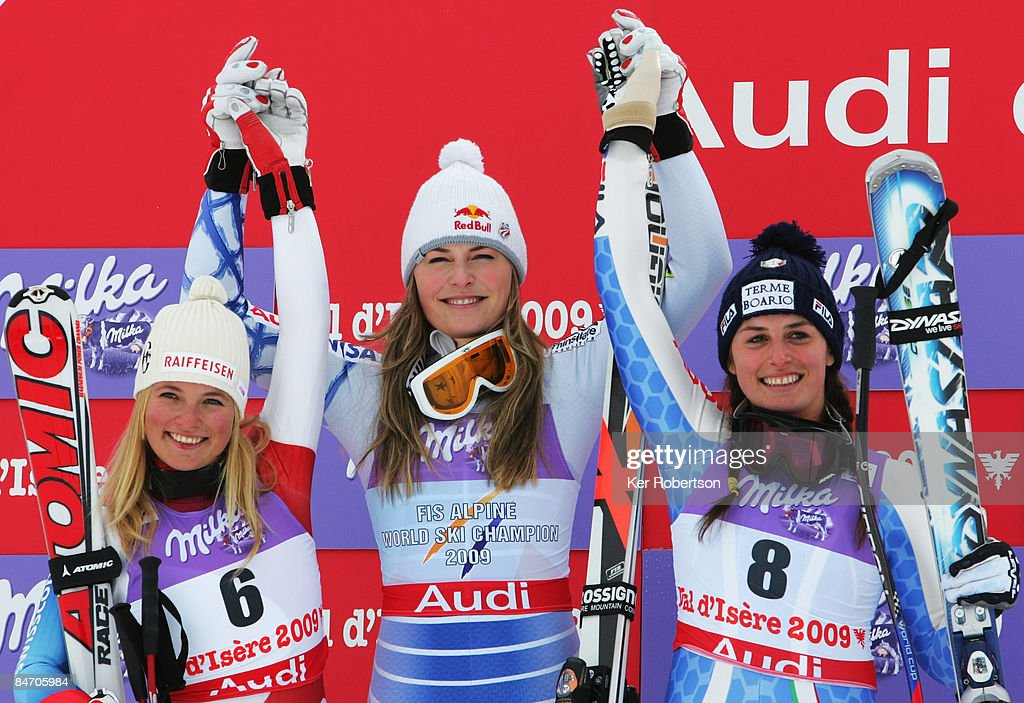 Second placed Lara Gut of Switzerland, race winner Lindsey Vonn of the USA and third placed Nadia Fanchini of Italy celebrate at the Flower Ceremony following the Women's Downhill event held on the Face de Solaise course on February 9, 2009 in Val d'Isere, France.