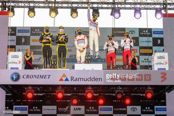 Second placed Latvia's driver Martins Sesks and Latvia's co-driver Renars Francis, winners Finland's driver Sami Pajari and Finland's co-driver Marko...