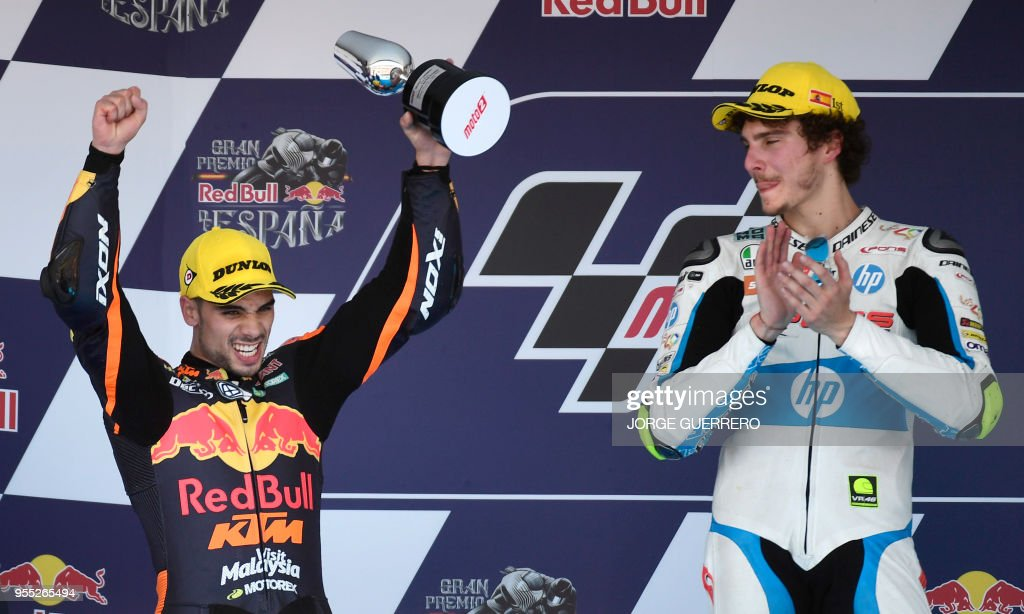 Second placed Leopard Racing's Portuguese rider Miguel Oliveira (L) celebrates on the podium beside first placed Forward Team's Italian rider Lorenzo Baldassarri after the Moto2 race of the Spanish Grand Prix at the Jerez Angel Nieto racetrack in Jerez de la Frontera on May 6, 2018.
