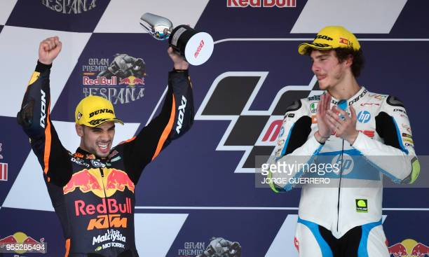 Second placed Leopard Racing's Portuguese rider Miguel Oliveira celebrates on the podium beside first placed Forward Team's Italian rider Lorenzo...