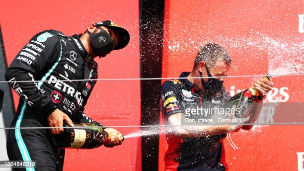 Second placed Lewis Hamilton of Great Britain and Mercedes GP celebrates on the podium during the F1 70th Anniversary Grand Prix at Silverstone on...