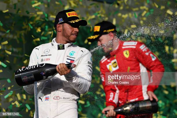 Second placed Lewis Hamilton of Great Britain and Mercedes GP celebrates on the podium during the Australian Formula One Grand Prix at Albert Park on...