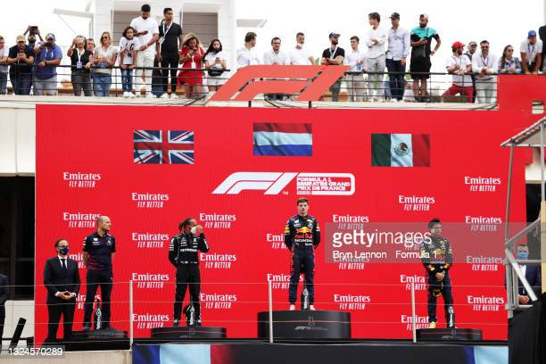 Second placed Lewis Hamilton of Great Britain and Mercedes GP, race winner Max Verstappen of Netherlands and Red Bull Racing and third placed Sergio...