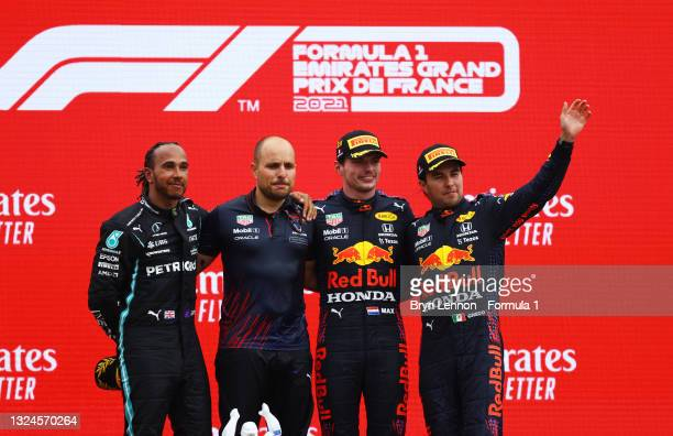 Second placed Lewis Hamilton of Great Britain and Mercedes GP, Red Bull Racing race engineer Gianpiero Lambiase, race winner Max Verstappen of...