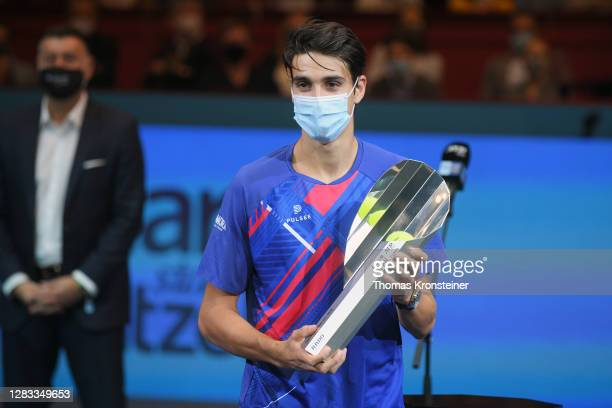 Second placed Lorenzo Sonego of Italy poses with his trophy after his final match against Andrey Rublev of Russia on day nine of the Erste Bank Open...
