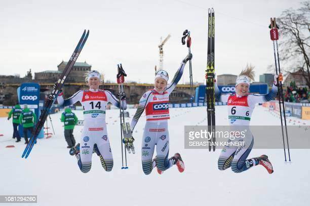 Second placed Maja Dahlqvist first placed Stina Nilsson and Jonna Sundling pose after the Women's Sprint Free event at the FIS Cross Country World...