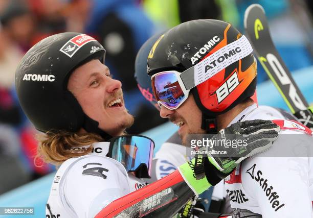 Second placed Manuel Feller and winner Marcel Hirscher from Austria react after the giant slalom competition of the FIS Alpine Ski World Cup in...