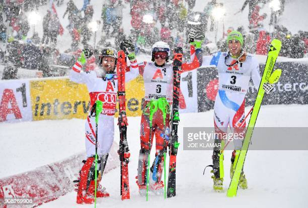 Second placed Marcel Hirscher of Austria winner Henrik Kristoffersen of Norway and third placed Daniel Yule of Switzerland pose after the men's...