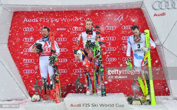 Second placed Marcel Hirscher of Austria winner Henrik Kristoffersen of Norway and third placed Daniel Yule of Switzerland pose on the podium after...