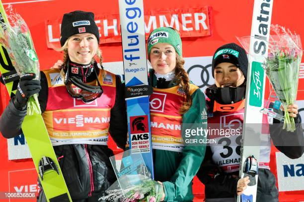 Second placed Maren Lundby of Norway first placed Juliane Seyfarth of Germany and third placed Sara Takanashi of Japan pose on the podium after the...