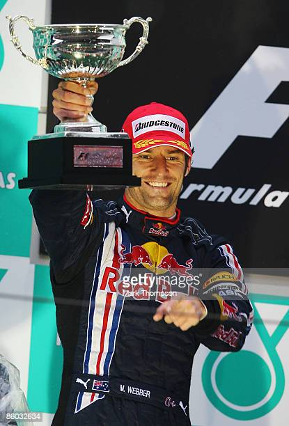 Second placed Mark Webber of Australia and Red Bull Racing celebrates on the podium after the Chinese Formula One Grand Prix at the Shanghai...