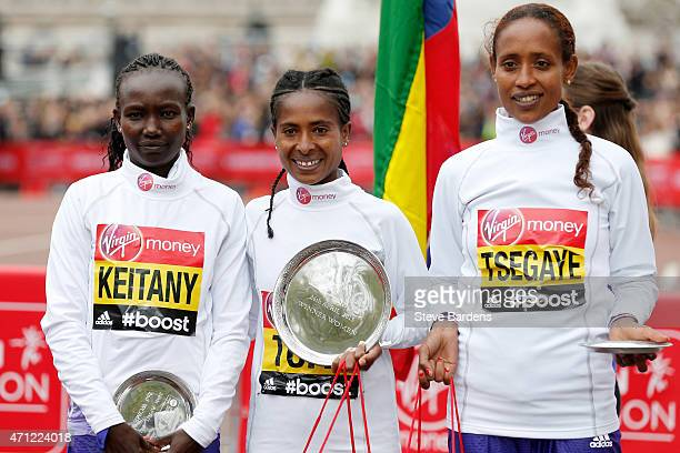 Second placed Mary Keitany of Kenya first placed Tigist Tufa of Kenya and third placed Tirfi Tsegaye of Ethiopia pose for the cameras following the...