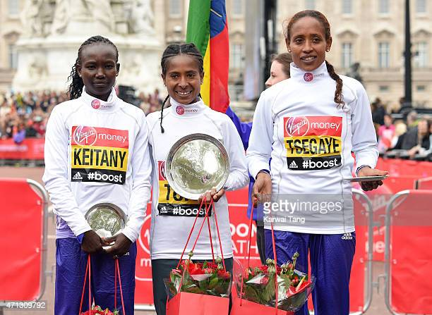 Second placed Mary Keitany of Kenya, first placed Tigist Tufa of Kenya and third placed Tirfi Tsegaye of Ethiopia pose for the cameras following the...