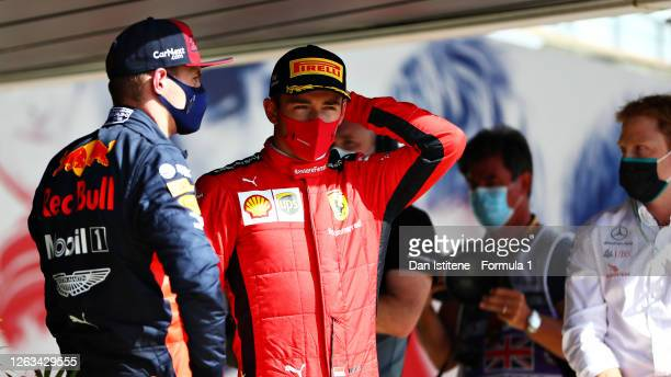 Second placed Max Verstappen of Netherlands and Red Bull Racing and third placed Charles Leclerc of Monaco and Ferrari talk in parc ferme during the...