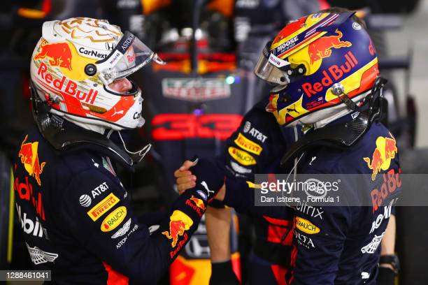 Second placed Max Verstappen of Netherlands and Red Bull Racing and third placed Alexander Albon of Thailand and Red Bull Racing celebrate in parc...