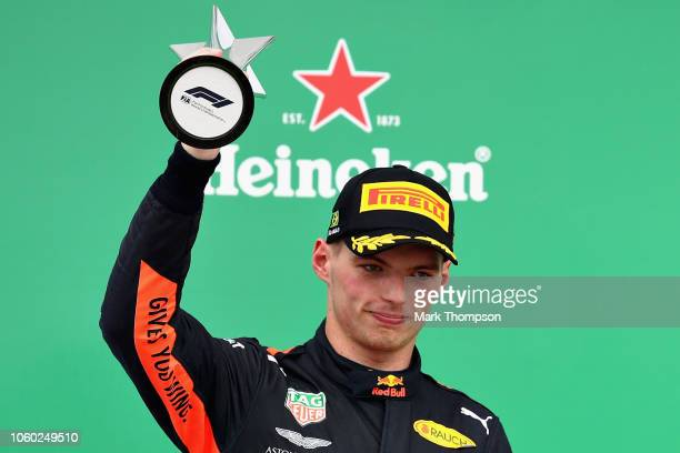 Second placed Max Verstappen of Netherlands and Red Bull Racing holds his trophy on the podium during the Formula One Grand Prix of Brazil at...