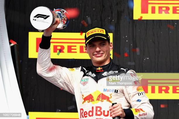 Second placed Max Verstappen of Netherlands and Red Bull Racing celebrates on the podium during the United States Formula One Grand Prix at Circuit...