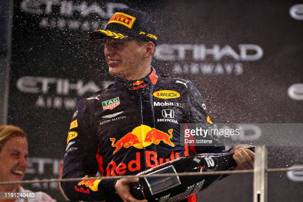Second placed Max Verstappen of Netherlands and Red Bull Racing celebrates on the podium during the F1 Grand Prix of Abu Dhabi at Yas Marina Circuit...