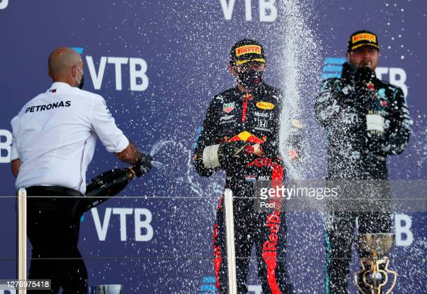 Second placed Max Verstappen of Netherlands and Red Bull Racing celebrates on the podium during the F1 Grand Prix of Russia at Sochi Autodrom on...