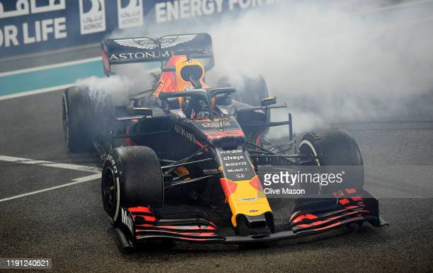 Second placed Max Verstappen of Netherlands and Red Bull Racing celebrates with donuts on track during the F1 Grand Prix of Abu Dhabi at Yas Marina...