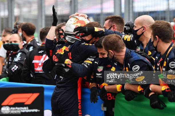 Second placed Max Verstappen of Netherlands and Red Bull Racing celebrates with team members in parc ferme after the Formula One Grand Prix of...