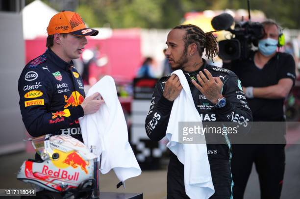 Second placed Max Verstappen of Netherlands and Red Bull Racing speaks with race winner Lewis Hamilton of Great Britain and Mercedes GP in parc ferme...