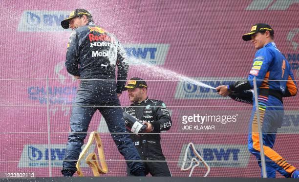 Second placed Mercedes' Finnish driver Valtteri Bottas , winner Red Bull's Dutch driver Max Verstappen and third placed McLaren's British driver...