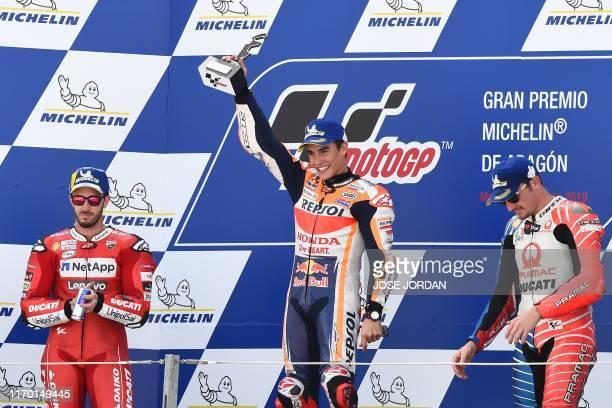 Second placed Mission Winnow Ducati's Italian rider Andrea Dovizioso, winner Repsol Honda Team's Spanish rider Marc Marquez and third placed Pramac...