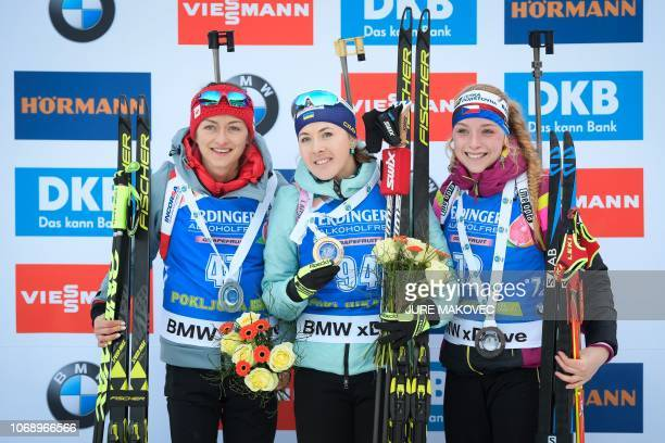 Second placed Monika Hojnisz of Poland winner Yuliia Dzhima of Ukraine and third placed Marketa Davidova of Czech Republic pose on the podium during...