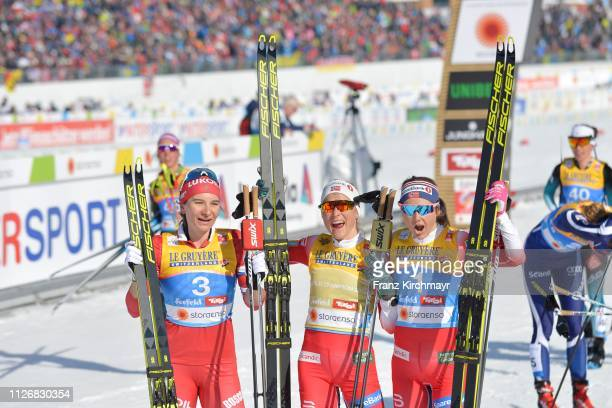 Second placed Natalia Nepryaeva of Russia, first placed Therese Johaug of Norway and third placed Ingvild Flugstad Ostberg of Norway pose on behind...