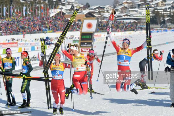Second placed Natalia Nepryaeva of Russia first placed Therese Johaug of Norway and third placed Ingvild Flugstad Ostberg of Norway pose on behind...