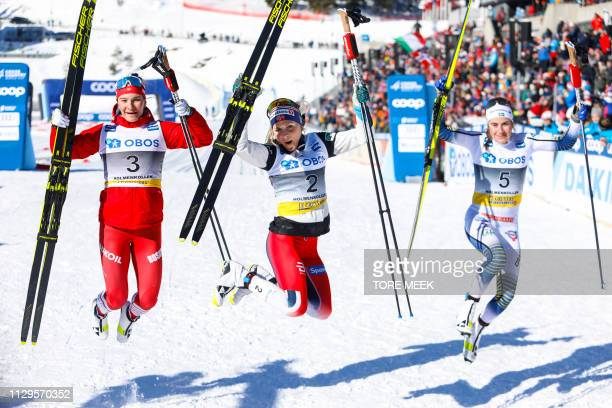 second placed Natalia Nepryaeva of Russia first placed Therese Johaug of Norway and third placed Ebba Andersson of Sweden celebrate after the FIS...