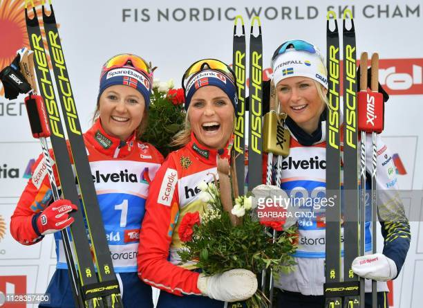 Second placed Norway's Ingvild Flugstad Oestberg winner Norway's Therese Johaug and third placed Sweden's Frida Karlsson celebrate during the flower...