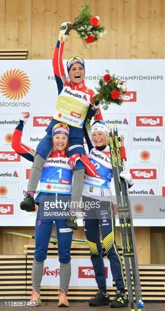 Second placed Norway's Ingvild Flugstad Oestberg winner Norway's Therese Johaug and third placed Sweden's Frida Karlsson celebrate during the podium...