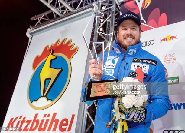 Second placed Norway's Kjetil Jansrud poses with the trophy during the winner ceremony of the Mens SuperG event at the FIS Alpine World Cup on...