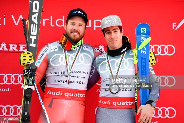 Second placed Norway's Kjetil Jansrud third placed France's Victor MuffatJeandet pose on the men's overall winner's podium of the alpine combined...