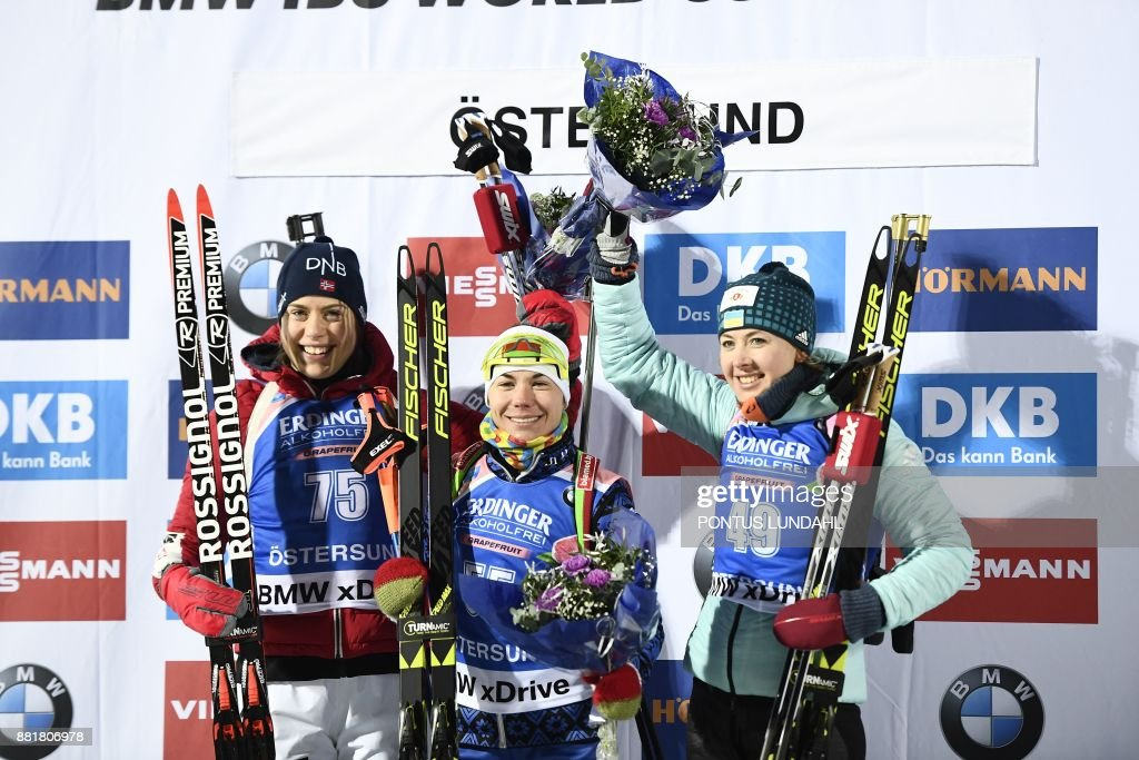 Second placed Norway's Synnoeve Solemdal, winner Nadezhda Skardino of Belarus and third placed Ukraine's Yuliia Dzhima pose after the women 15 km individual event at the IBU World Cup Biathlon in Ostersund, Sweden, on November 29, 2017. / AFP PHOTO / TT News Agency / Pontus LUNDAHL / Sweden OUT / The erroneous mention[s] appearing in the metadata of this photo by Pontus LUNDAHL has been modified in AFP systems in the following manner: [Yuliia Dzhima] instead of [Nadezhda Skardino]. Please immediately remove the erroneous mention[s] from all your online services and delete it (them) from your servers. If you have been authorized by AFP to distribute it (them) to third parties, please ensure that the same actions are carried out by them. Failure to promptly comply with these instructions will entail liability on your part for any continued or post notification usage. Therefore we thank you very much for all your attention and prompt action. We are sorry for the inconvenience this notification may cause and remain at your disposal for any further information you may require.