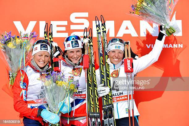 second placed Norway's Therese Johaug Norway's winner Marit Bjoergen and third placed Sweden's Charlotte Kalla celebrate on the podium after the...