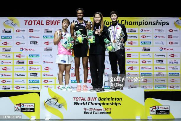 Second placed Nozomi Okuhara of Japan champion Pusarla V Sindhu of India and third placed Ratchanok Intanon of Thailand and Chen Yufei of China pose...