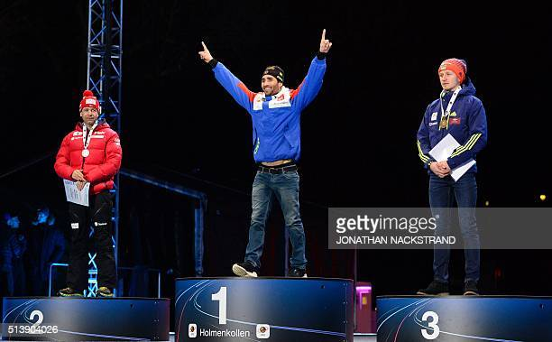 Second placed Ole Einar Bjorndalen of Norway winner Martin Fourcade of France third placed Ukraine's Sergey Semenov pose during a medal ceremony...