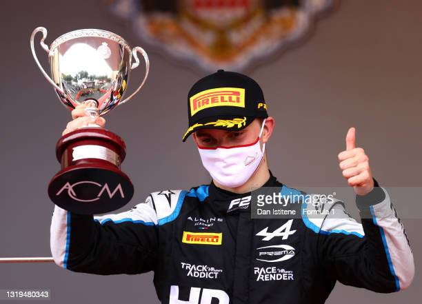 Second placed Oscar Piastri of Australia and Prema Racing celebrates on the podium during the Feature Race of Round 2:Monte Carlo of the Formula 2...